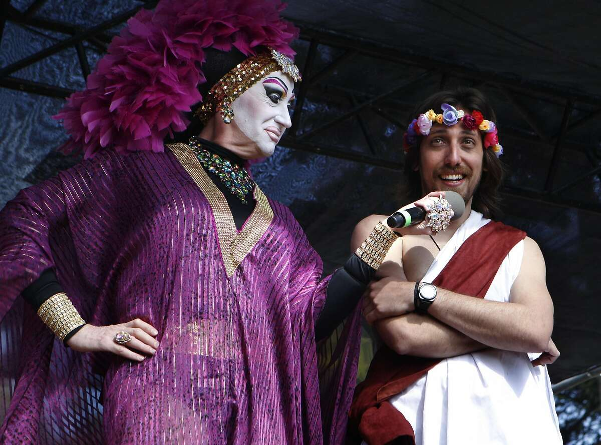 Hunky Jesus contestant Tiago Afonso, right, speaks with one of the judges Sister Roma during the 37th annual Easter in the Park celebration put on by the Sisters of Perpetual Indulgence in San Francisco, Calif., on Sunday March 27, 2016.