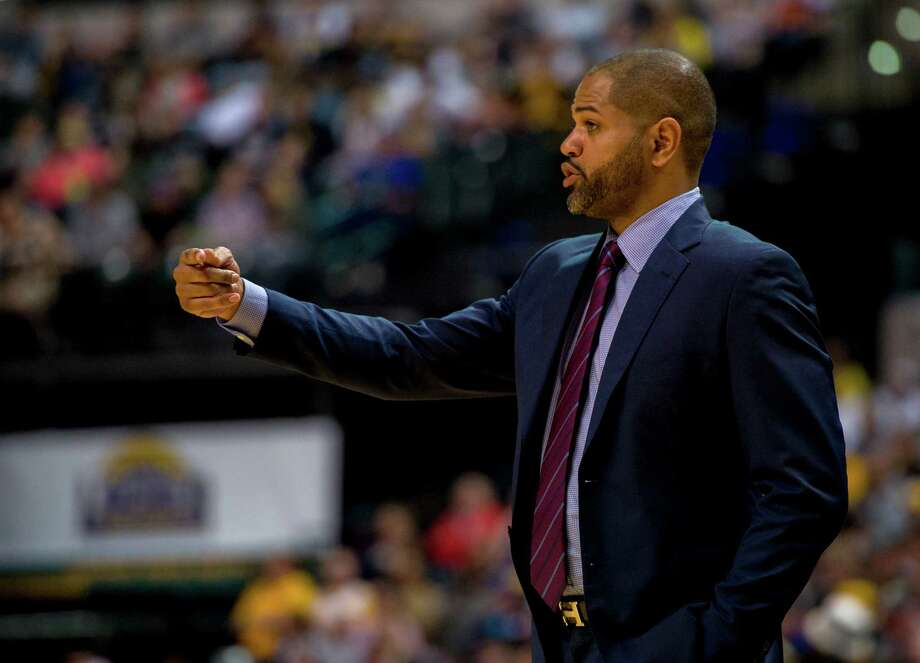 Houston Rockets head coach J.B. Bickerstaff communicates with players on the court during the second half of an NBA basketball game against the Indiana Pacers, Sunday, March 27, 2016, in Indianapolis. Photo: Doug McSchooler, AP / FR170771 AP