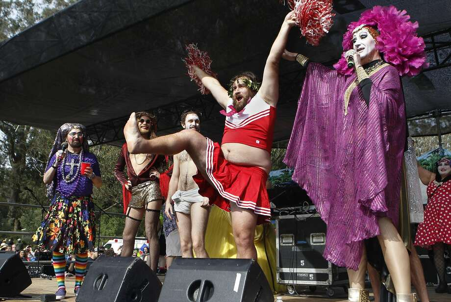 "Sister Roma, right, announces ""Cheerleader Jesus"", center, as the winner of this years Hunky Jesus Competition at the 37th annual Easter in the Park celebration put on by the Sisters of Perpetual Indulgence in San Francisco, Calif., on Sunday March 27, 2016. Photo: Brittany Murphy, The Chronicle"