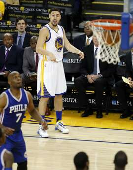 Golden State Warriors' Klay Thompson watches his successful 3-pointer in 3rd quarter against Philadelphia 76ers during NBA game at Oracle Arena in Oakland, Calif., on Sunday, March 27, 2016.
