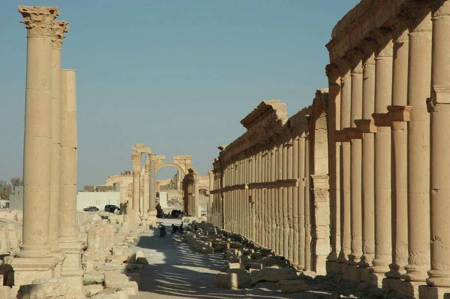 FILE - This undated file image released by UNESCO shows the site of the ancient city of Palmyra, Syria. Palmyra is an archaeological gem that Syrian troops took back from Islamic State fighters, Sunday, March 27, 2016. A desert oasis surrounded by palm trees in central Syria, Palmyra is also a strategic crossroads linking the Syrian capital, Damascus with the country's east and neighboring Iraq. Home to 65,000 people before the latest fighting, the town is located 155 miles (215 kilometers) east of Damascus. (Ron Van Oers, UNESCO via AP, File) ORG XMIT: CAITH102 Photo: Ron Van Oers / UNESCO