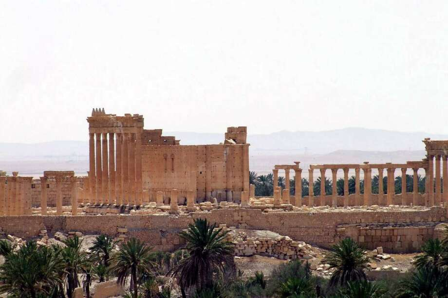FILE -- This file photo released May 17, 2015, by the Syrian official news agency SANA, shows a general view of Palmyra, Syria. Palmyra is an archaeological gem that Syrian troops took back from Islamic State fighters, Sunday, March 27, 2016. A desert oasis surrounded by palm trees in central Syria, Palmyra is also a strategic crossroads linking the Syrian capital, Damascus with the country's east and neighboring Iraq. Home to 65,000 people before the latest fighting, the town is located 155 miles (215 kilometers) east of Damascus. (SANA via AP, File) ORG XMIT: CAITH103 Photo: Uncredited / SANA