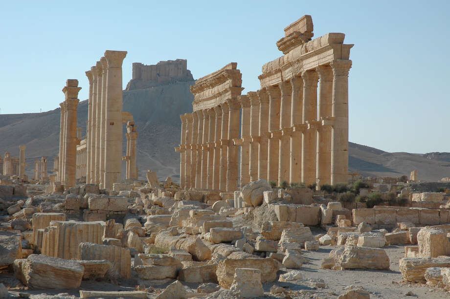FILE - This undated file image released by UNESCO shows the site of the ancient city of Palmyra in Syria. Palmyra is an archaeological gem that Syrian troops took back from Islamic State fighters, Sunday, March 27, 2016. A desert oasis surrounded by palm trees in central Syria, Palmyra is also a strategic crossroads linking the Syrian capital, Damascus with the country's east and neighboring Iraq. Home to 65,000 people before the latest fighting, the town is located 155 miles (215 kilometers) east of Damascus.  (Ron Van Oers, UNESCO via AP, File) ORG XMIT: CAITH101 Photo: Ron Van Oers / UNESCO