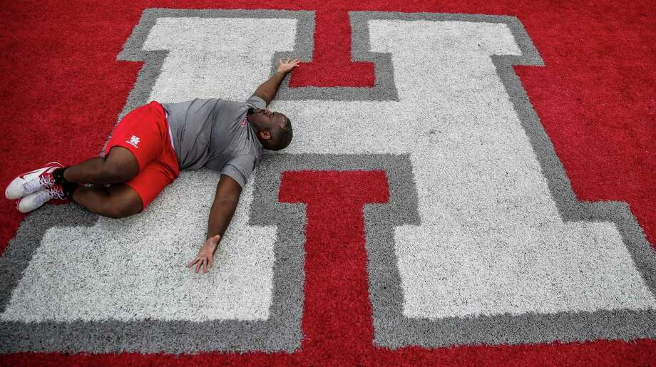 University of Houston football player Melvin Holland stretches in the end zone of TDECU Stadium before the 40-yard dash during UH Pro Day Thursday, March 24, 2016 in Houston. Photo: Michael Ciaglo, Houston Chronicle / © 2016  Houston Chronicle