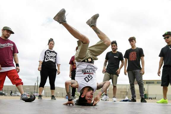 Roy Perez break dances as others watch and wait their turn during the Break Free Hip Hop School fundraiser being held at 8th Wonder Brewery, 2202 Dallas St., Wednesday, March 23, 2016, in Houston. The event is as a fundraiser for scholarships for 2,016 students. The group plans to break dancing nonstop until they reach their goal.