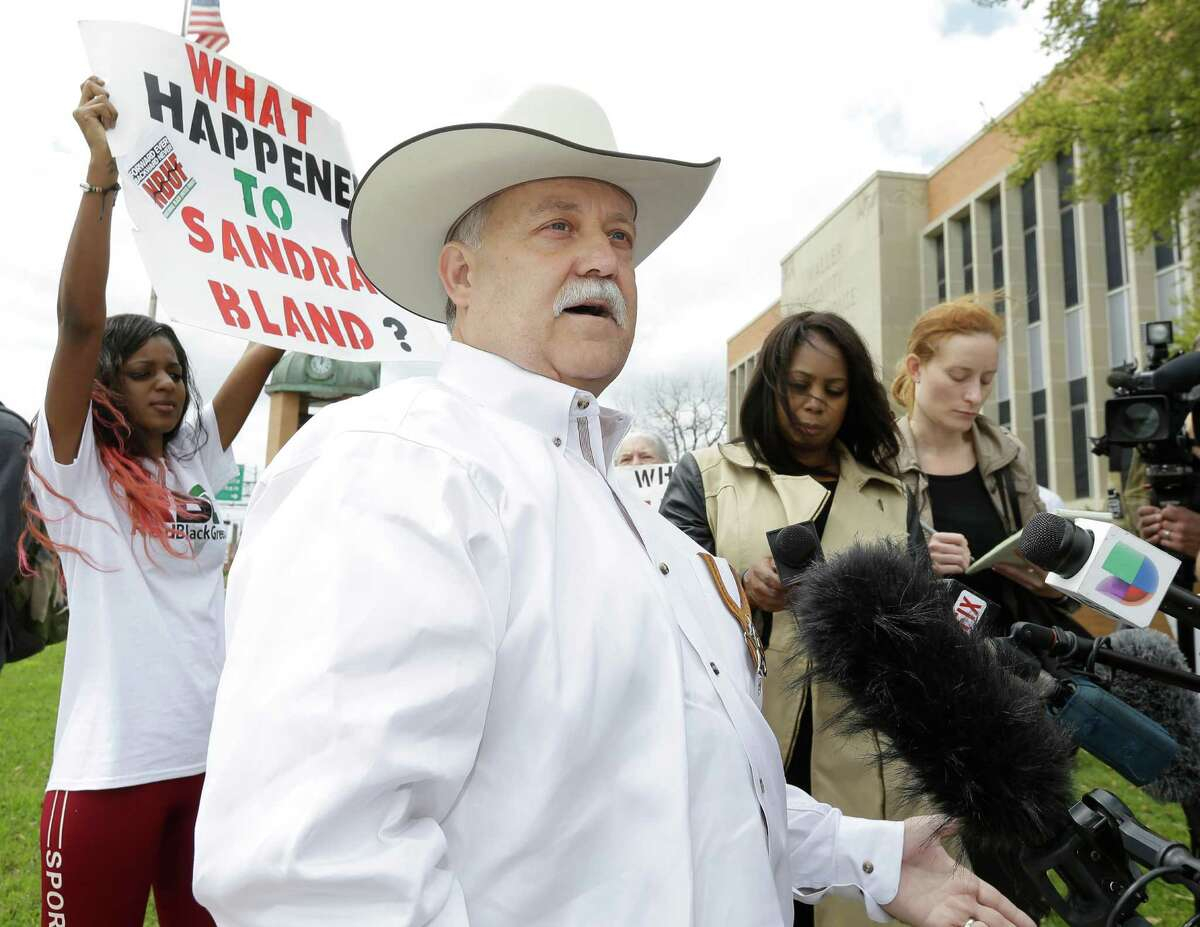 Protesters shout as Waller County Sheriff Glenn Smith speaks to the media outside the Waller County Courthouse Tuesday, March 22, 2016, in Houston.