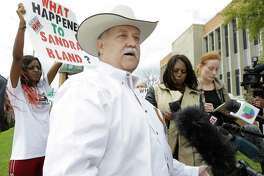 Protesters shout as Waller County Sheriff Glenn Smith speaks to the media outside the Waller County Courthouse Tuesday, March 22, 2016, in Houston. Brian Encinia, the former Texas Department of Public Safety trooper who arrested Sandra Bland, made an appearance before a judge on misdemeanor perjury charges.