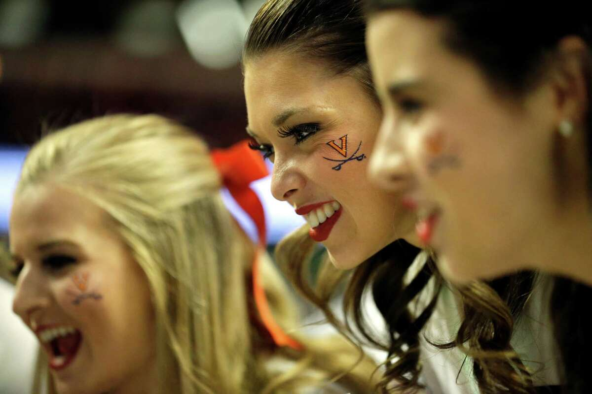 Virginia cheerleaders cheer before an NCAA college basketball game between Virginia and Syracuse in the regional finals of the NCAA Tournament, Sunday, March 27, 2016, in Chicago.