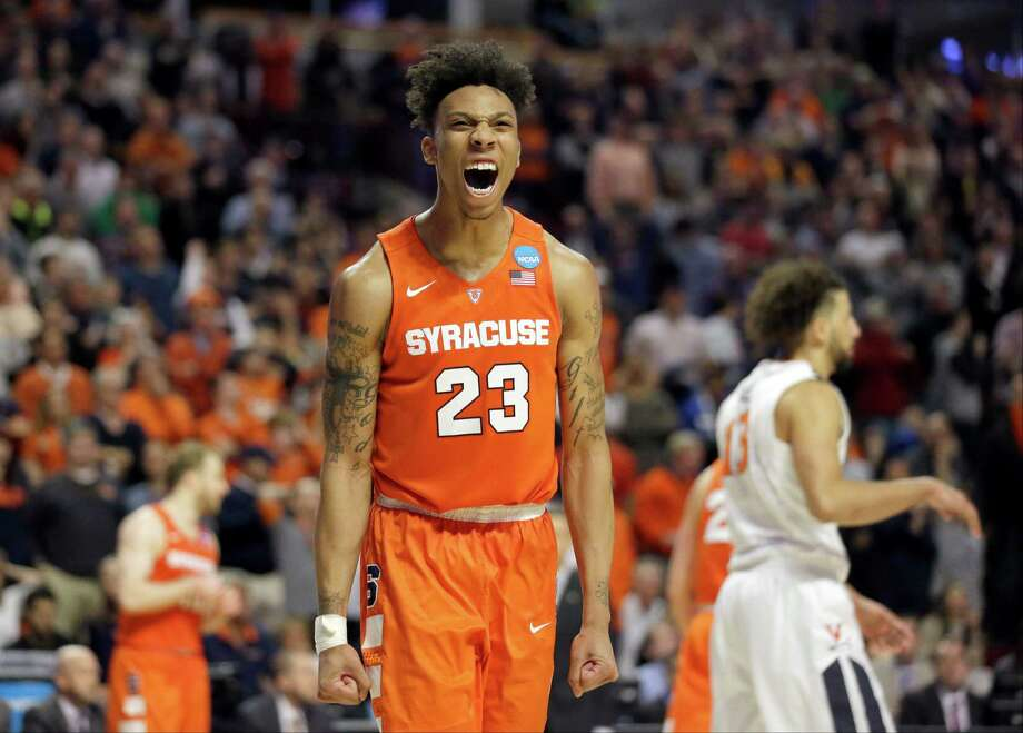 Syracuse freshman forward Malachi Richardson had reason to celebrate after scoring 23 points to lift the 10th-seeded Orange past top-seeded Virginia 68-62 in Sunday's Midwest Regional title game in Chicago. Photo: Nam Y. Huh, STF / AP