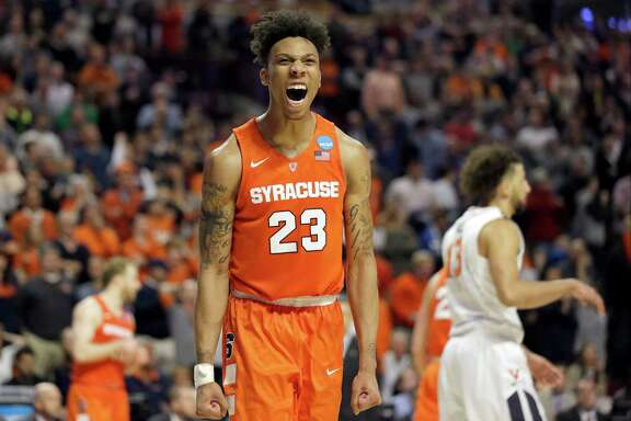 Syracuse freshman forward Malachi Richardson had reason to celebrate after scoring 23 points to lift the 10th-seeded Orange past top-seeded Virginia 68-62 in Sunday's Midwest Regional title game in Chicago.
