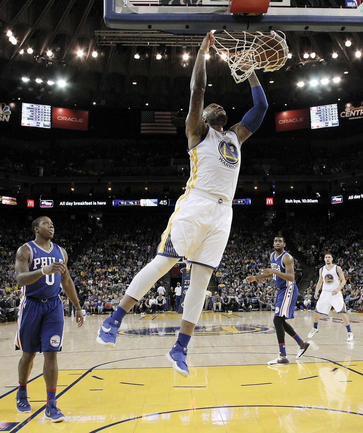 Marreese Speights (5) dunks in the first half as the Golden State Warriors played the Philadelphia 76ers at Oracle Arena in Oakland, Calif., on Sunday, March 27, 2016.