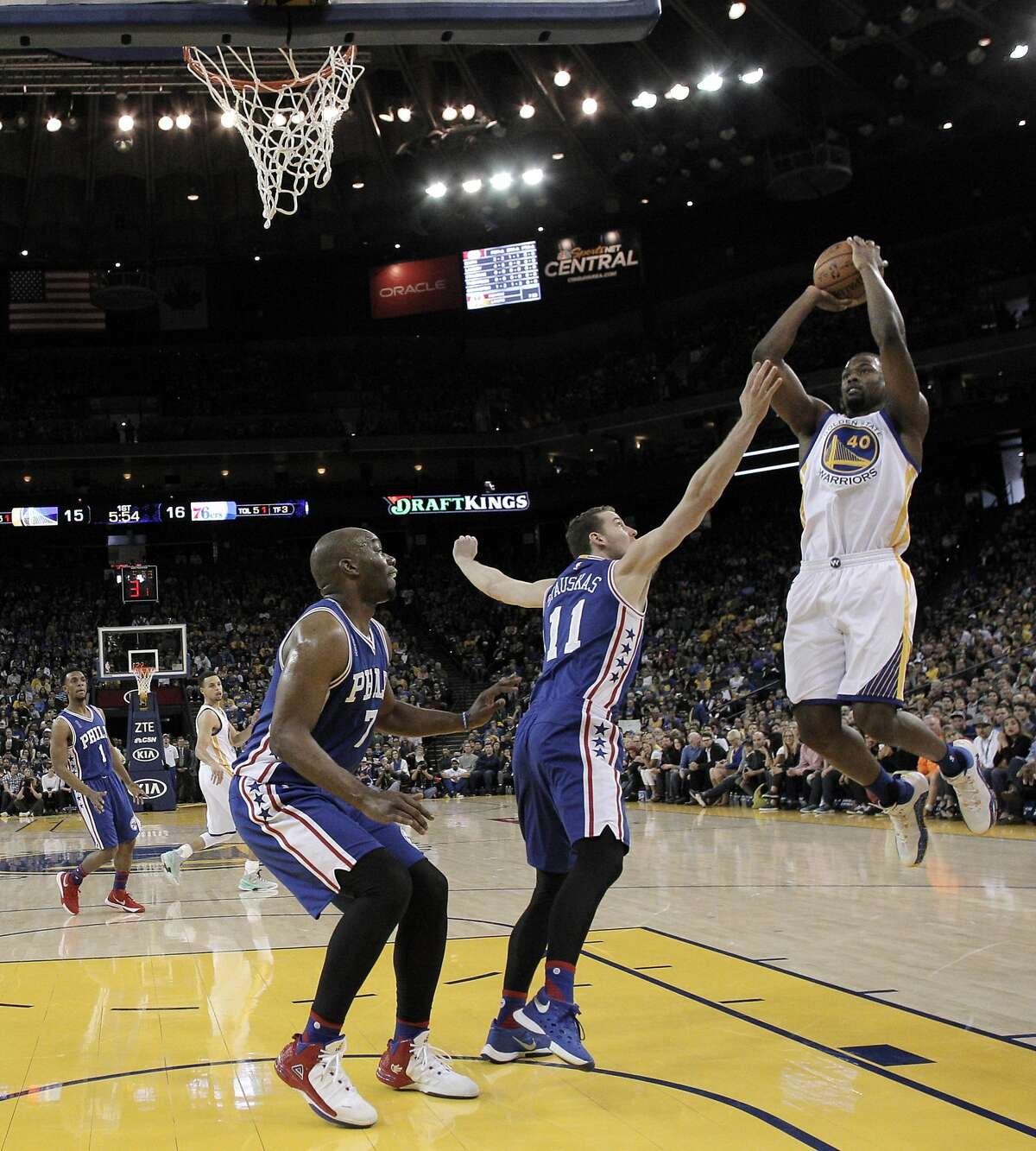 Harrison Barnes (40) puts up a jumper in the first half as the Golden State Warriors played the Philadelphia 76ers at Oracle Arena in Oakland, Calif., on Sunday, March 27, 2016.