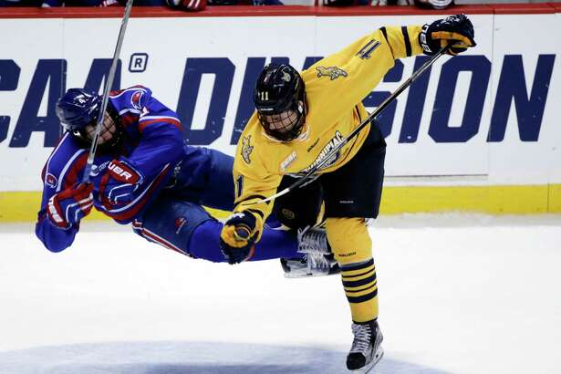 Quinnipiac's Tim Clifton (11) hits UMass Lowell's Chris Forney during the third period of the NCAA men's East Regional championship hockey game, Sunday, March 27, 2016, in Albany, N.Y. Quinnipiac won 4-1. (AP Photo/Mike Groll) ORG XMIT: NYMG121