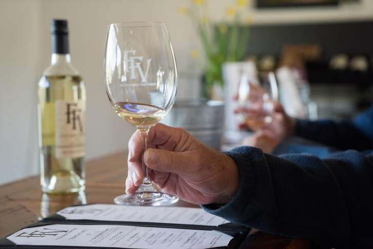 Bill Edmunds samples wine at Fults Winery in Lower Lake, Calif. on Saturday, March 26, 2016. Fults features a Wildfire Blend that gives some proceeds to firefighters.
