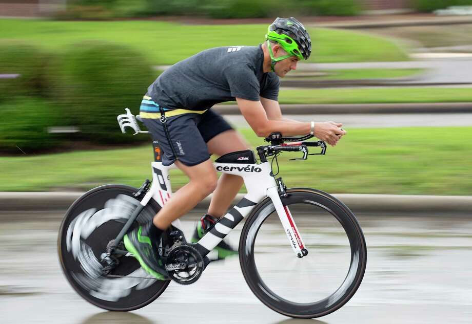 Thousands of athletes and spectators are set to flock to The Woodlands for the Ironman Texas triathlon race on May 14, but the route for the 112-mile bike ride is yet to be determined. Photo: Thomas B. Shea, Freelance / © 2015 Thomas B. Shea
