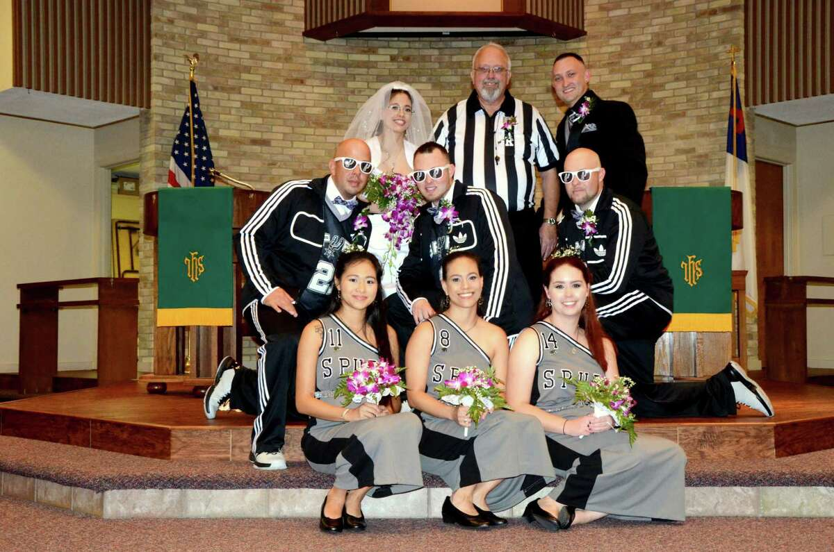 Love isn't a game for a local couple, but their Silver and Black-inspired wedding epitomized Spurs fan marriage goals.