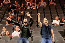 Spurs fans Fran Saez (right) and Miguel Botia from both from Spain dance before the game against the Memphis Grizzlies at the AT&T Center on Friday, Mar. 25, 2016. (Kin Man Hui/San Antonio Express-News)