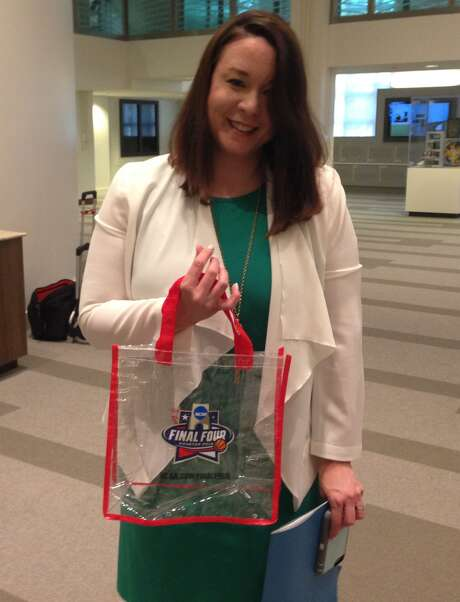 Rachel Quan with Houston's NCAA tournament host committee, shows off one of the clear bags officials will hand out. Only clear bags will be allowed into Final Four events.