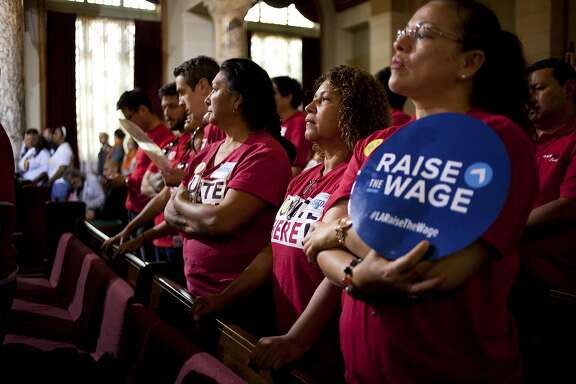 FILE � Members of Unite Here Local 11 attend a City Council meeting where the minimum wage was raised in Los Angeles, May 19, 2015. California lawmakers have reached a tentative deal to raise the state minimum wage to $15 an hour by 2022, potentially marking the biggest advance yet in a campaign to increase pay for low-income workers that the has reverberated across the country. (Jenna Schoenefeld/The New York Times)