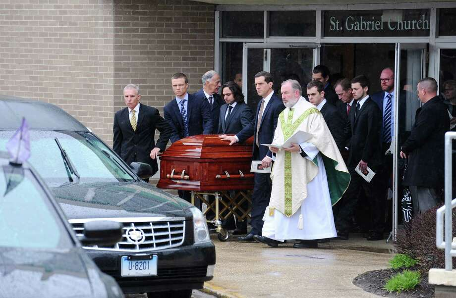 Dylan Pape's casket gets wheeled out of Saint Gabriel Roman Catholic Church in Stamford, Conn. following his funeral on Monday. Pape was shot and killed by police last Monday at his home. Photo: Michael Cummo / Hearst Connecticut Media / Stamford Advocate