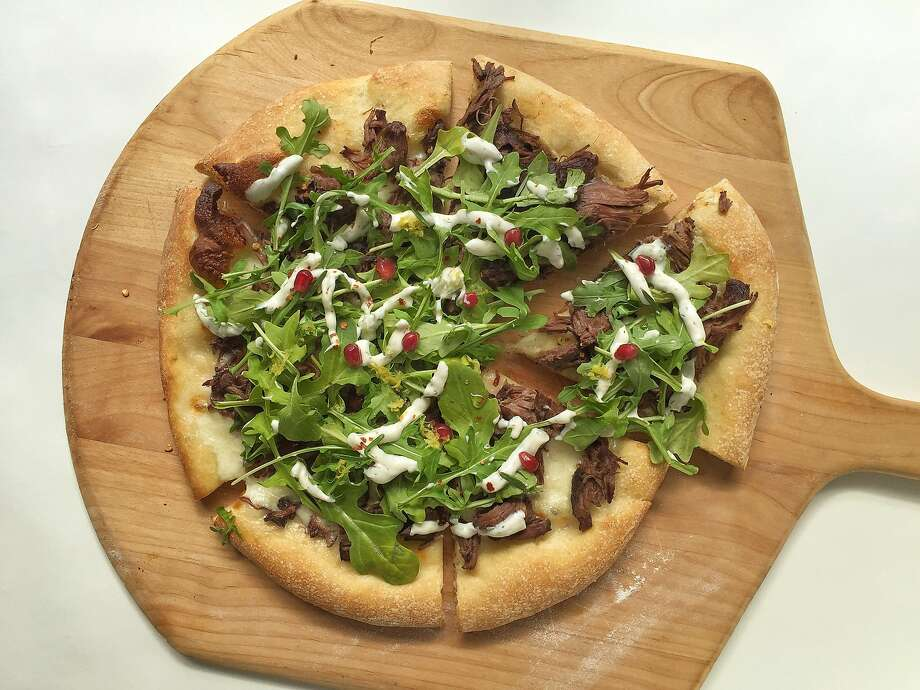 Pizza with spicy braised lamb, tzatziki, arugula and rosemary syrup from Laura Meyer Photo: Amanda Gold