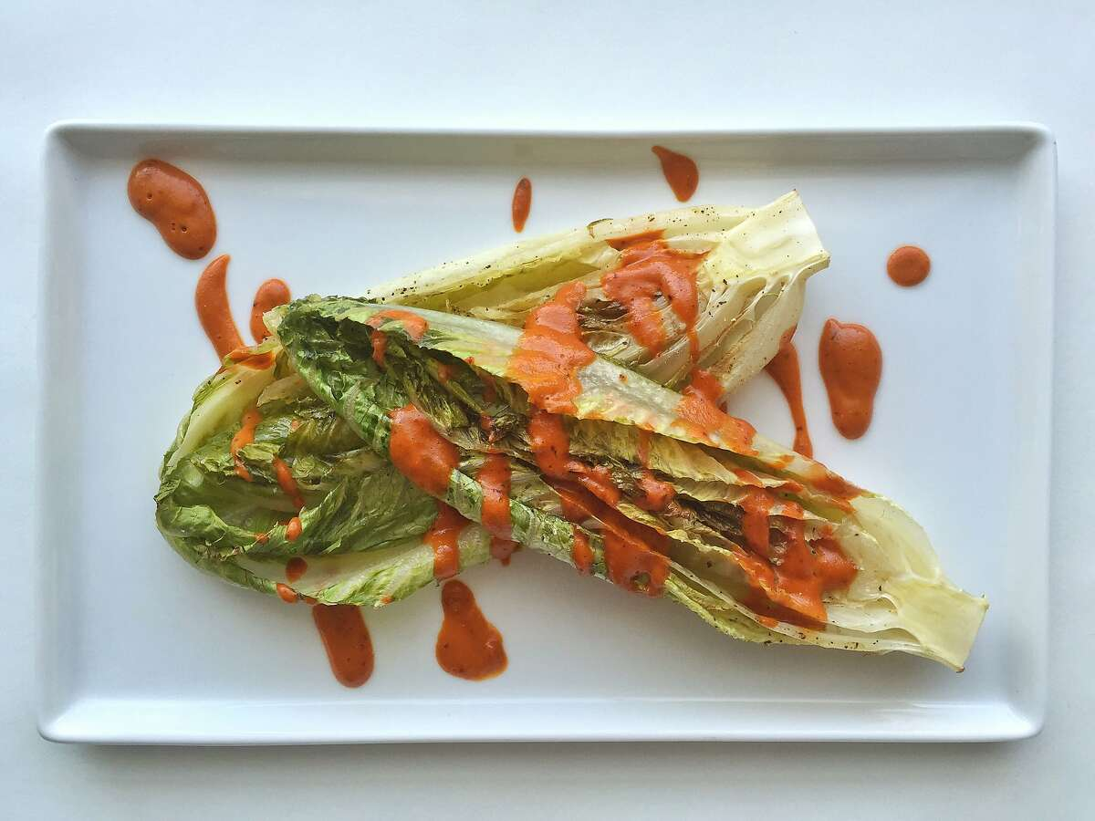 Cooked lettuces with chile Caesar sauce from Val Cantu