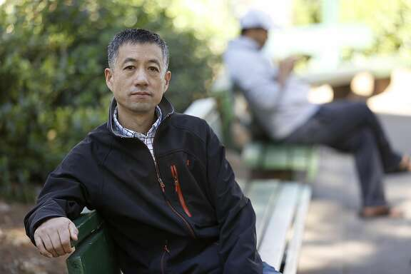 Jim Chen worked at UCSF as a janitor for over 3 years making $18 an hour and talks about his pay cut  last year to minimum wage at Washington Square in San Francisco, California, on monday, march 28, 2016.