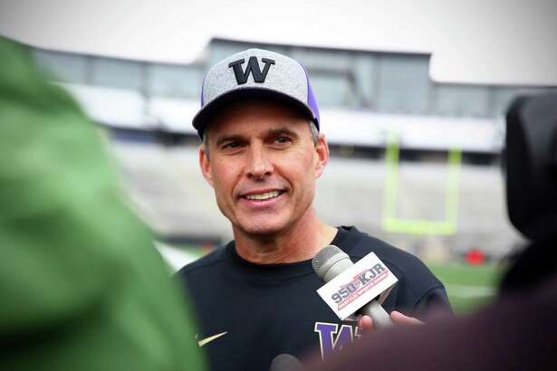 University of Washington head coach Chris Petersen is interviewed following the team's first spring practice of the year, Monday, Mar. 28, 2016.