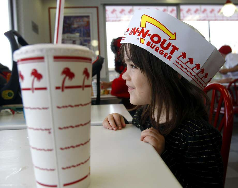 Rylee Jones wears a paper hat as she attends the grand opening Thursday Nov. 20, 2014 of San Antonio's first In-N-Out Burger.  Photo: William Luther, San Antonio Express-News