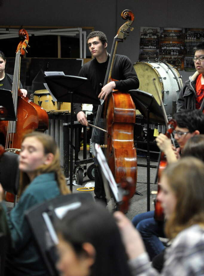 "Bethel Public SchoolsPictured: Senior Ben Fitzpatrick, 17, plays the bass during orchestra class at Bethel High School. Fitzpatrick will be one of only 32 high school students from across the country to travel to Los Angeles for a week long music program ""2016 Grammy Camp - Jazz Session"" Fitzpatrick was chosen for his baritone saxophone talent but he also plays the bass, piano and clarinet. Wednesday, February 3, 2016, in Bethel, Conn. Photo: H John Voorhees III / Hearst Connecticut Media / The News-Times"