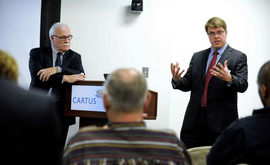 Bob Santy, left, president of Connecticut Economic Resource Center and Bart Kollen, deputy commissioner with the department of economic and community development, address a Danbury Regional Economic Development Forum held at Cartus in Danbury, Monday, March 28, 2016. Photo: Carol Kaliff / Hearst Connecticut Media / The News-Times