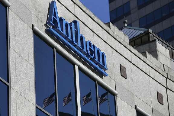 FILE - In this Thursday, Feb. 5, 2015, file photo, the Anthem logo hangs at the health insurer's corporate headquarters in Indianapolis. Anthem reports financial results, Wednesday, Jan. 27, 2016. (AP Photo/Michael Conroy, File)