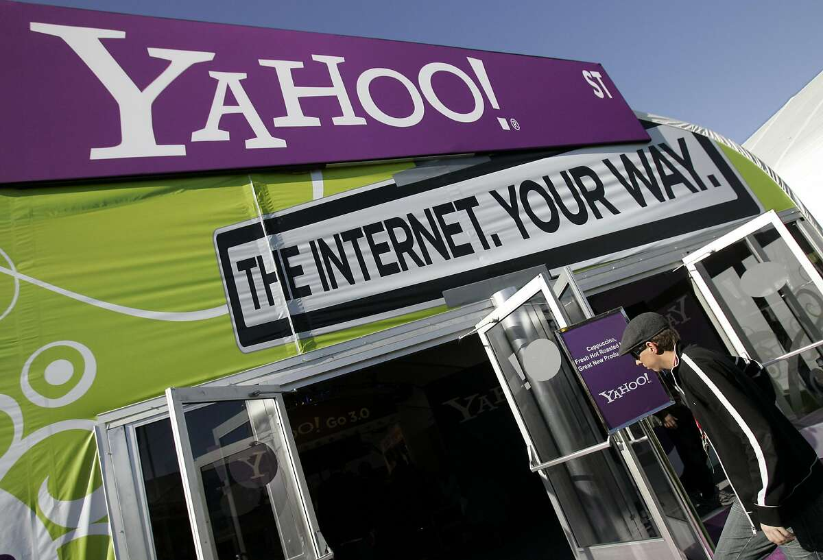 The Yahoo tent at the Consumer Electronics Show (CES) is seen in Las Vegas, Monday, Jan. 7, 2008. Battered by slow revenue growth and the popularity of social networking Web sites, Yahoo! Inc. is poised to lay off hundreds of workers, according to published reports. (AP Photo/Paul Sakuma)