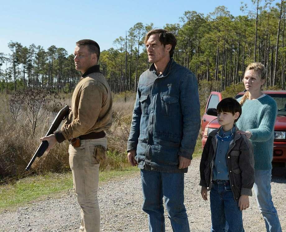 Joel Edgerton (left), Michael Shannon, Jaeden Lieb erher and Kirsten Dunst in an unsatisfying drama. Photo: Ben Rothstein, TNS