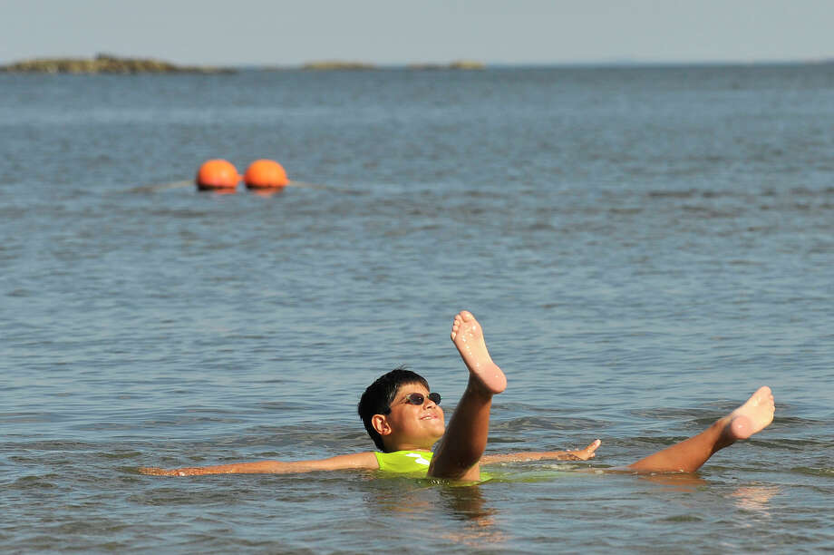 Vincent Reppucci, 9, floats lazily in the water at West Beach in Stamford, Conn., during last August's heatwave. In anticipation of the season and in keeping with a water safety grant, the city and the Stamford YMCA are offering swimming classes. Photo: Jason Rearick / Hearst Connecticut Media / Stamford Advocate