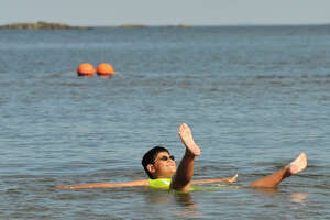 Vincent Reppucci, 9, floats lazily in the water at West Beach in Stamford, Conn., during last August's heatwave. In anticipation of the season and in keeping with a water safety grant, the city and the Stamford YMCA are offering swimming classes.