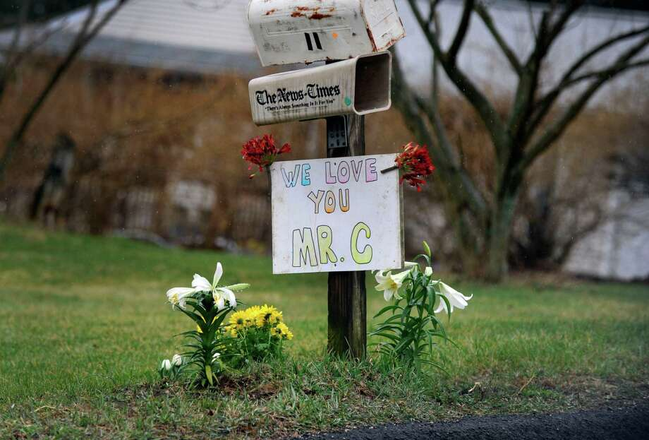 A make-shift memorial remembering Charles Cristofalo is seen on the the mailbox post at his home at 11 Governor's Lane in Bethel, Monday, March 28, 2016. Cristofalo, 76, died Friday in a  fatal shooting that rocked a placid Bethel neighborhood. Thai Pham, 56, whom neighbors said was Charles Cristofalo's wife and Ahn Cristofalo, 68, were also shot and injured at the home, police said. Photo: Carol Kaliff / Hearst Connecticut Media / The News-Times