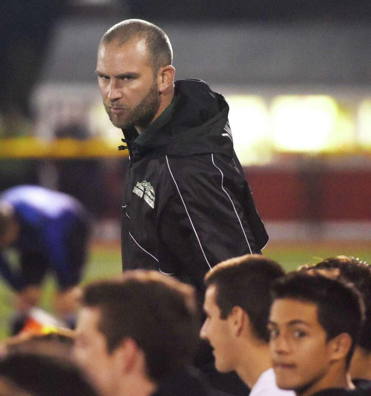 New Milford coach Antony Howard talks with his team in Joel Barlow's 4-0 win over New Milford in the SWC high school boys soccer semifinal game at Penders Field in Stratford, Conn. Tuesday, Oct. 28, 2014.