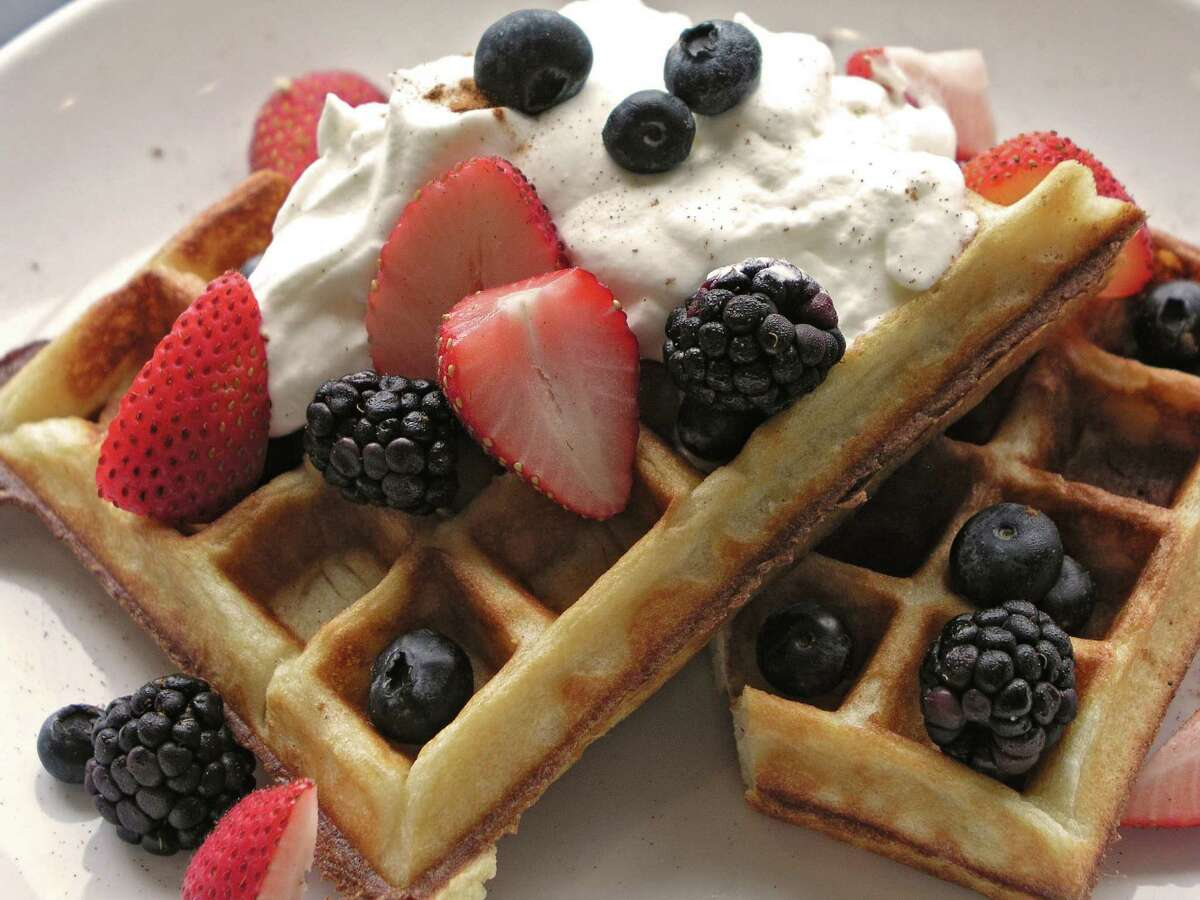 Buttermilk waffle with maple syrup, whipped cream and berries at Shade restaurant in the Heights, 250 W 19th Street.
