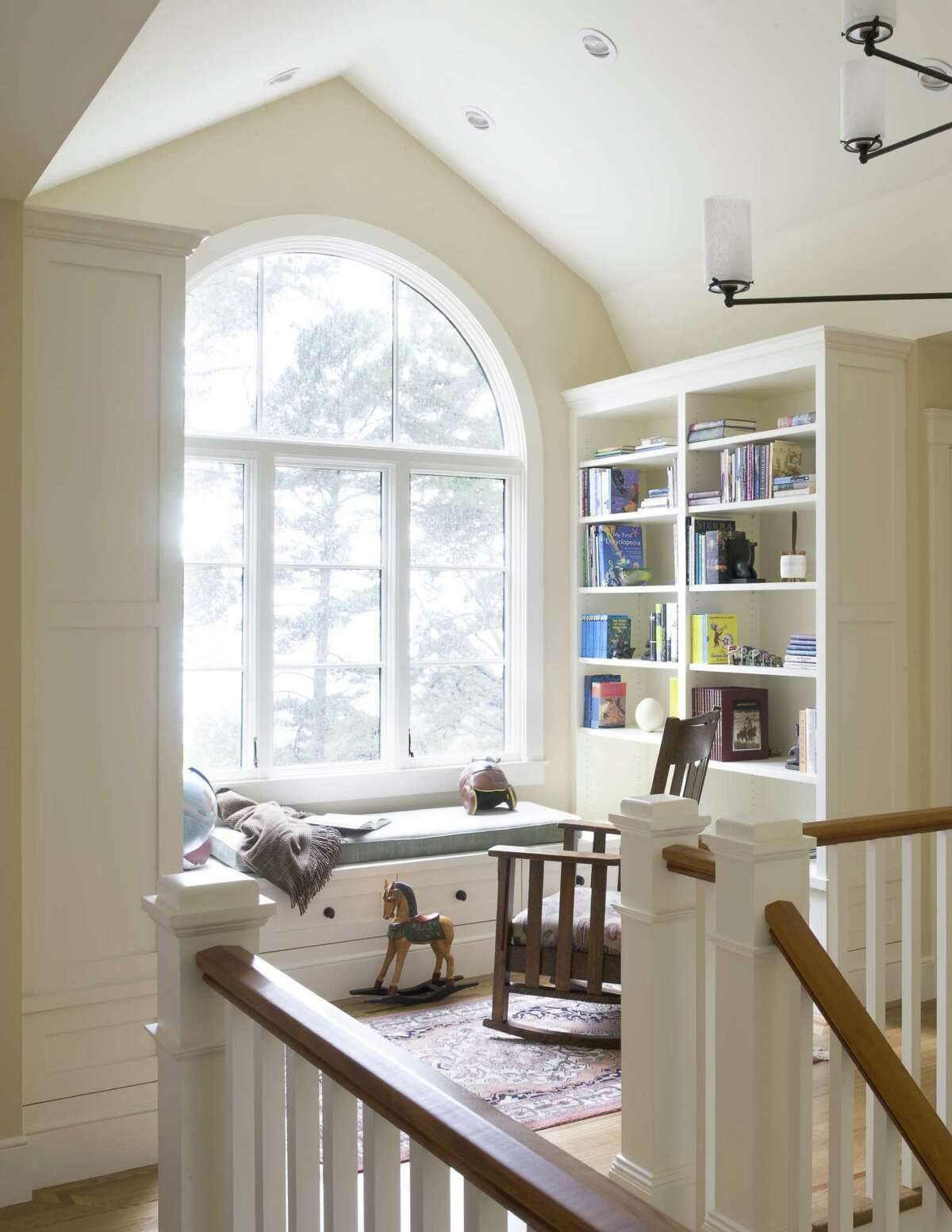 Even with a small landing, you can create a reading nook with a built-in banquette window seat.