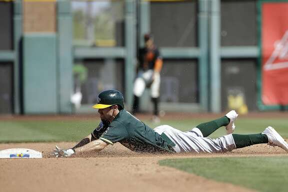 Oakland Athletics' Billy Burns against the San Francisco Giants during a spring training baseball game in Scottsdale, Ariz., Saturday, March 19, 2016. (AP Photo/Jeff Chiu)