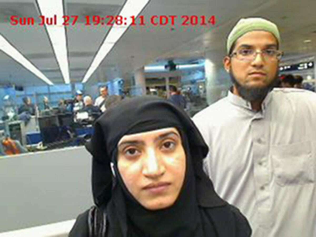 In this July 27, 2014, file photo, provided by U.S. Customs and Border Protection shows Tashfeen Malik, left, and Syed Farook, as they passed through O'Hare International Airport in Chicago. The bodies of the husband and wife behind the California shootings in San Bernardino on Dec. 2, 2015, have been released by authorities and buried Tuesday, Dec. 15 in Southern California. (U.S. Customs and Border Protection via AP, File)