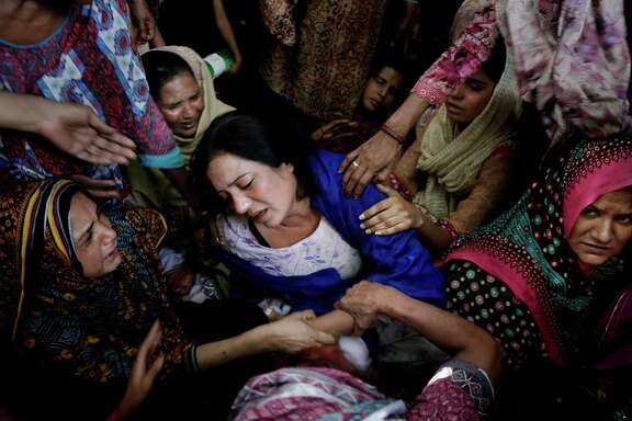 "A mother who lost her son in Sunday's suicide bombing of a public park in Lahore, Pakistan, is comforted by other women Monday. Recent attacks in the nation have aimed for ""soft targets"" like playgrounds and schools."