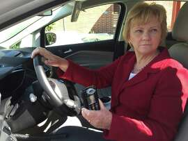 Mary Klotzbach, whose son was killed by a drunk driver, demonstrates an ignition interlock device on her vehicle that would prevent convicted DUI offenders from starting their cars while enebriated.