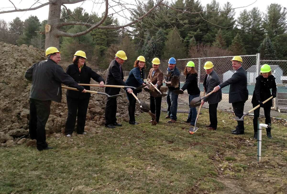 The town of Guilderland broke ground on March 24 for a pool building at Tawasentha Park. Mark Schafer of M.A. Schafer Construction has begun the foundation work with an estimated completion of mid-June. State Sen. George Amedore and Assemblywoman Pat Fahy were joined by John Decatur of Arthur J. Gallagher & Co., Town Board member Rosemary Centi, Supervisor Peter G. Barber, Parks Supervisor Greg Wier, Ken Johnson of Delaware Engineering, Town Board Member Lee Carman, and Linda Cure and Amy Boyt of the Parks & Recreation Department. (Submitted by Linda Cure)