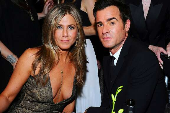 Jennifer Aniston, left, and Justin Theroux pose in the audience at the 21st annual Screen Actors Guild Awards at the Shrine Auditorium on Sunday, Jan. 25, 2015, in Los Angeles. (Photo by Vince Bucci/Invision/AP)