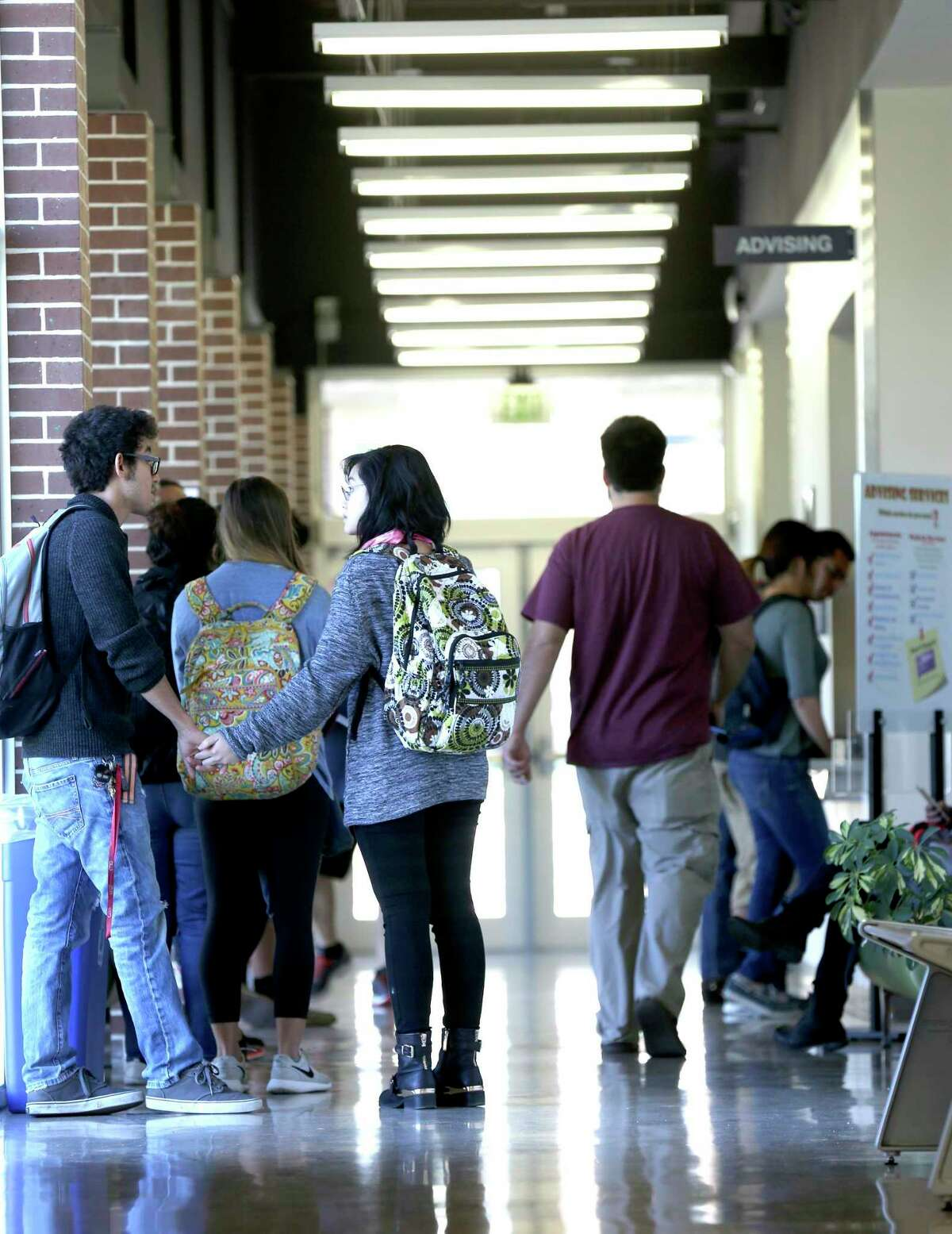 Students line up in 2015 outside the Northwest Vista College's Cypress Campus Center advising area. The Alamo Colleges and UTSA are partnering to offer a co-enrollment program for aspiring teachers.
