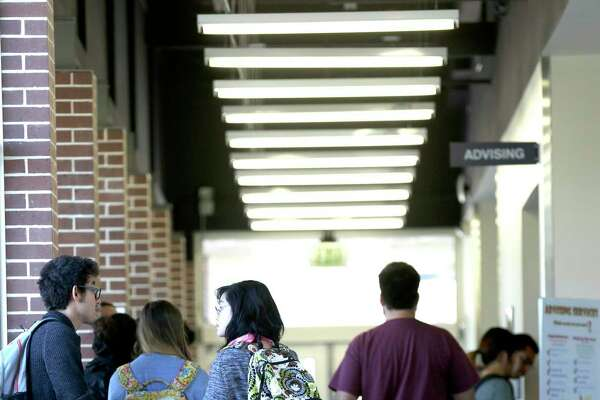 Students line up at Northwest Vista College's Cypress Campus Center advising area in this 2015 file photo. Northwest Vista is one of five colleges in the Alamo Colleges District, whose board election May 5 features multiple challenges to four incumbents.