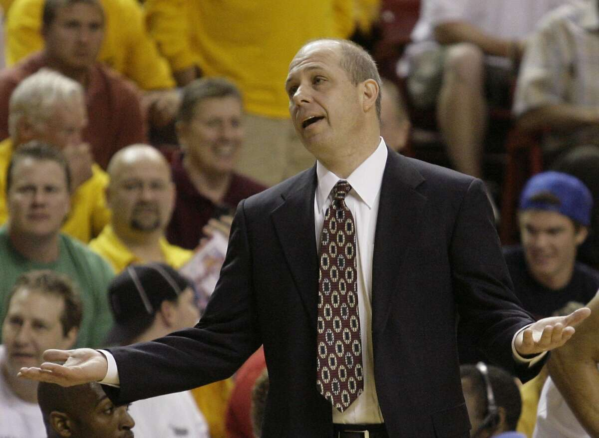 Arizona State coach Herb Sendek talks with a referee who called a travel against one of Sendek's players in the first half of an NCAA basketball game against UCLA on Thursday, Feb. 28, 2008, in Tempe, Ariz. (AP Photo/Paul Connors)