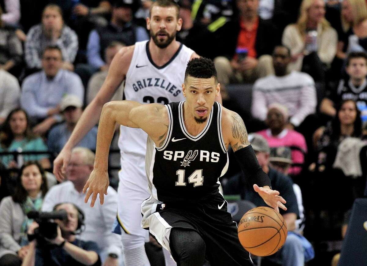 San Antonio Spurs guard Danny Green (14) brings the ball up ahead of Memphis Grizzlies center Marc Gasol during the second half of an NBA basketball game Wednesday, Jan. 24, 2018, in Memphis, Tenn. (AP Photo/Brandon Dill)